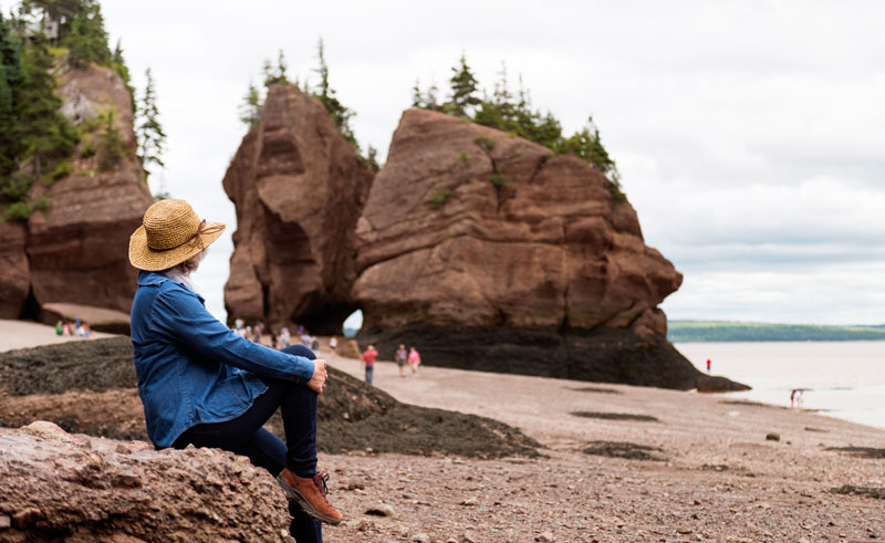 canada new brunswick woman at hopewell rocks fundy istk