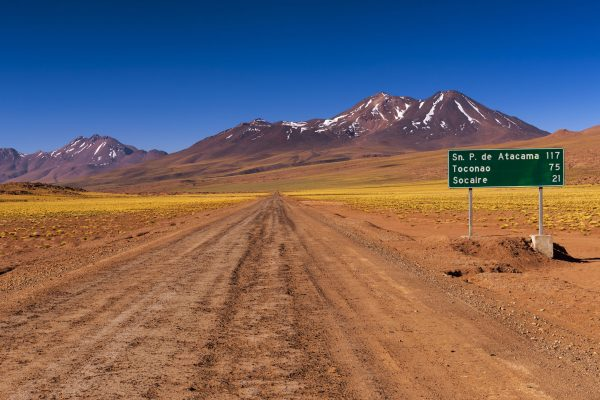 chile atacama desert dirt road and sign istk