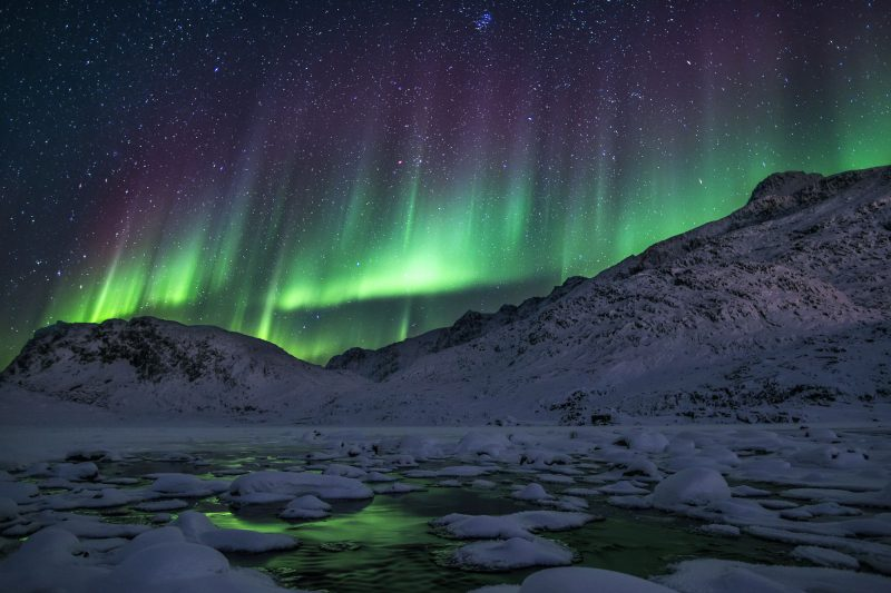 greenland northern lights over ice filled fjord tb