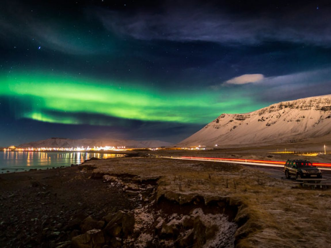 iceland northern lights along coast road rth
