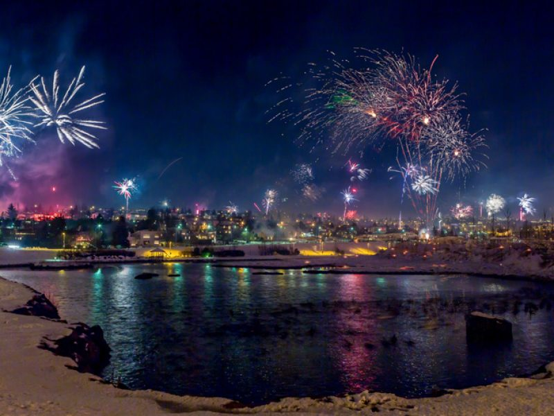 iceland reykjavik new year fireworks across lake rth