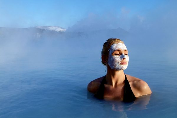 iceland south west blue lagoon woman with silica mud blgn