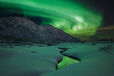 northern norway aurora over river malangen resort