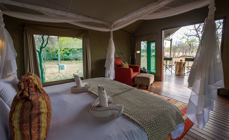 ongava tented camp bedroom interior