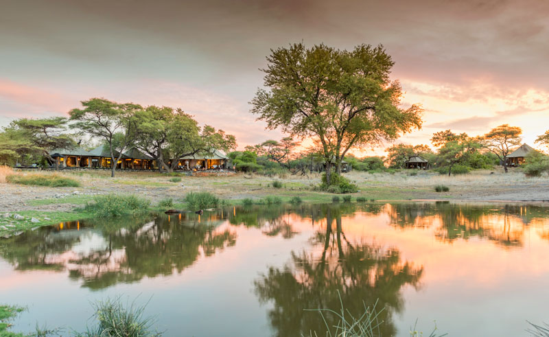 onguma tented camp sunset by water