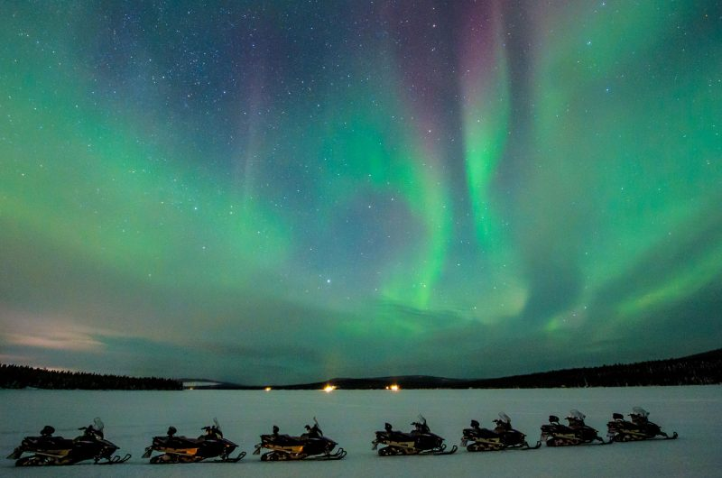 swedish lapland icehotel northern lights by snowmobile