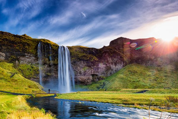 iceland south west seljalandsfoss lone person sunburst istk
