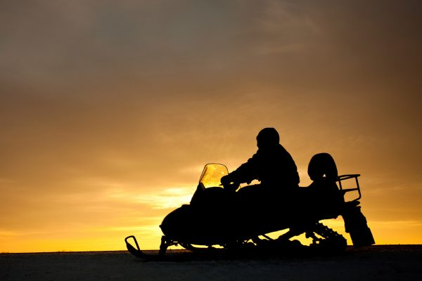 norway sunset snowmobiling istk