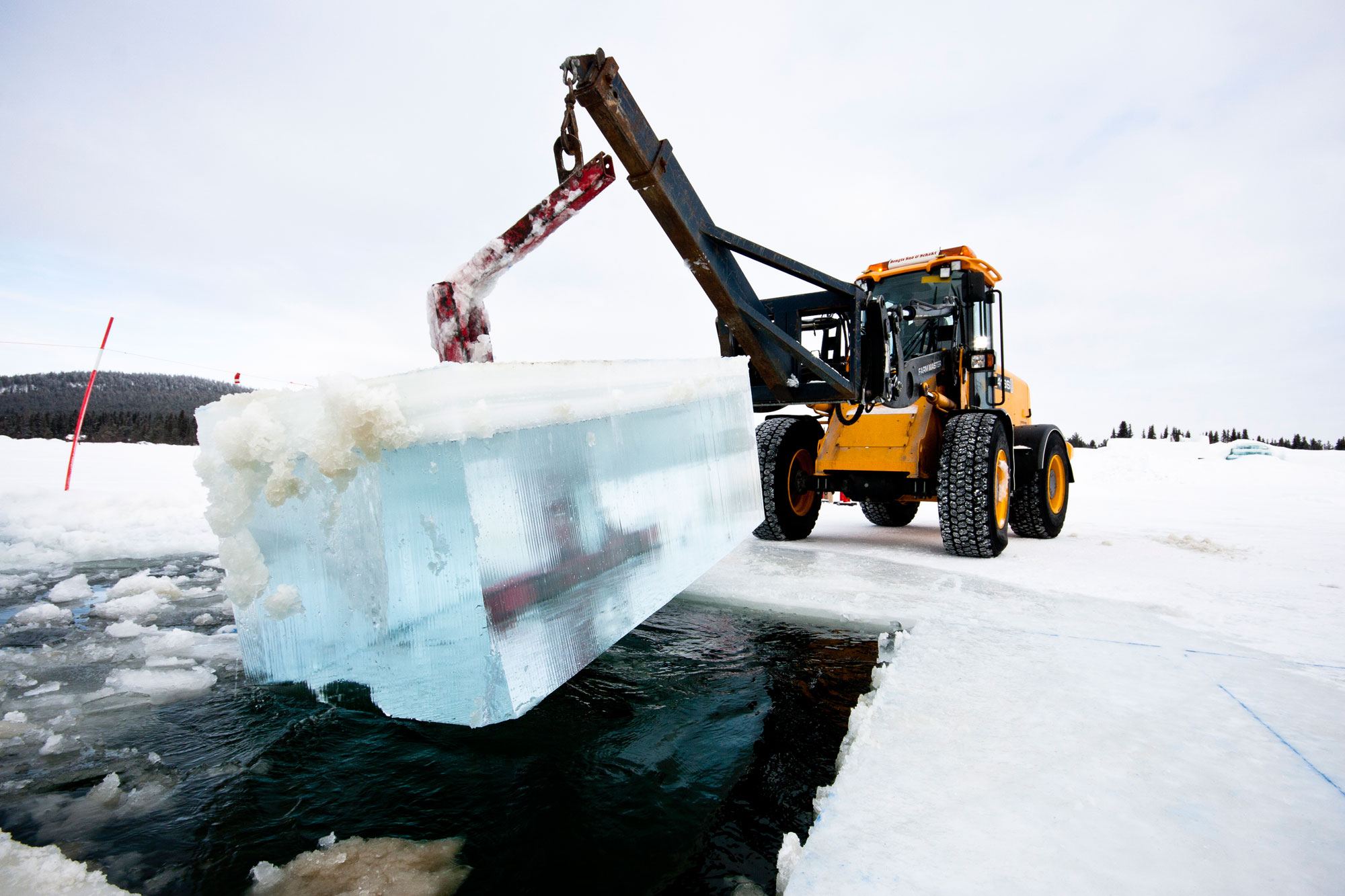 swedish lapland jukkasjarvi tractor with ice blocks icehotel ms