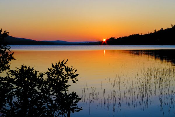 swedish lapland midnight sun over lake istk