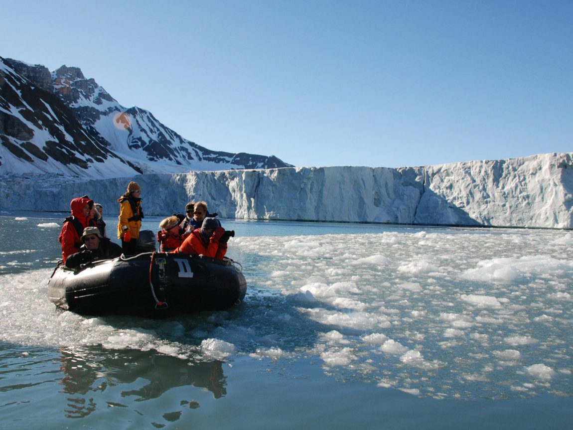arctic spitsbergen zodiac group at glacier front rp