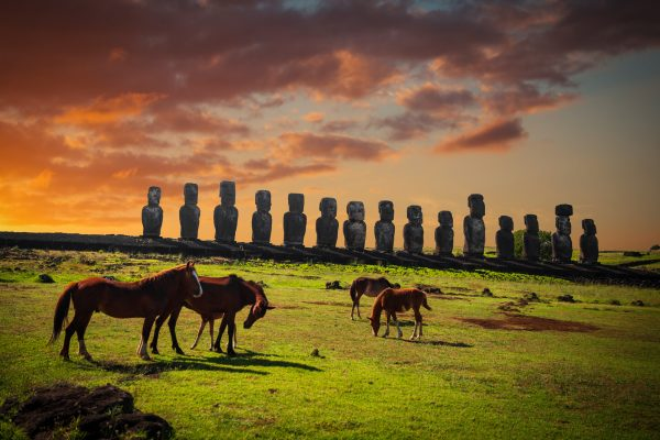 chile easter island moais horses at sunset istk