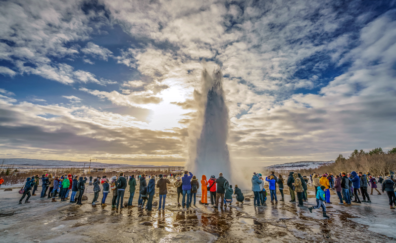 iceland golden circle group watching strokkur erupting