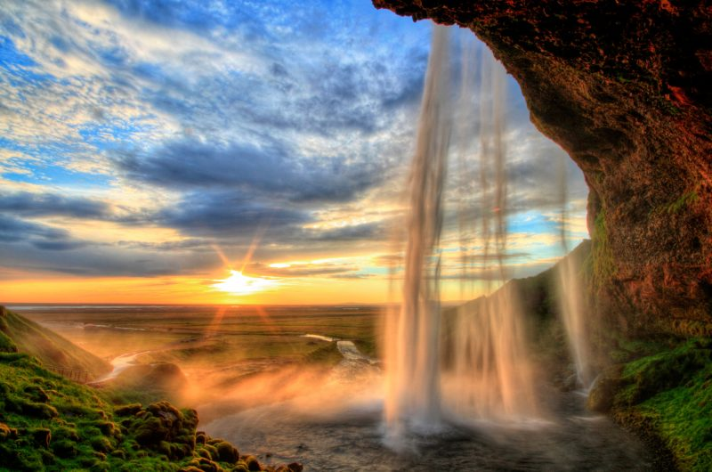 iceland seljalandsfoss summer sunset cloudy sky istk