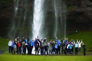 iceland students jumping waterfall