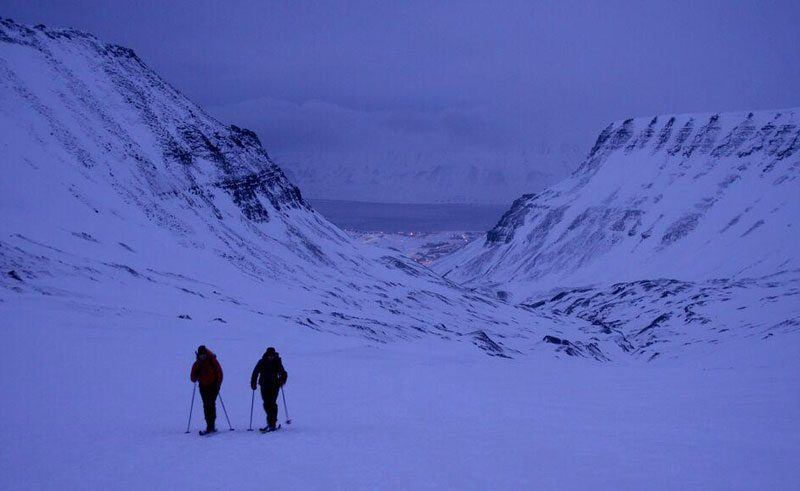 melanie windridge hiking through snow violet dusk