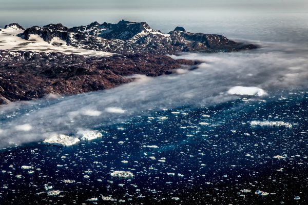 east greenland sermilik ice fjord partially covered in fog vg