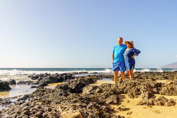 hawaii maui older couple on beach istk