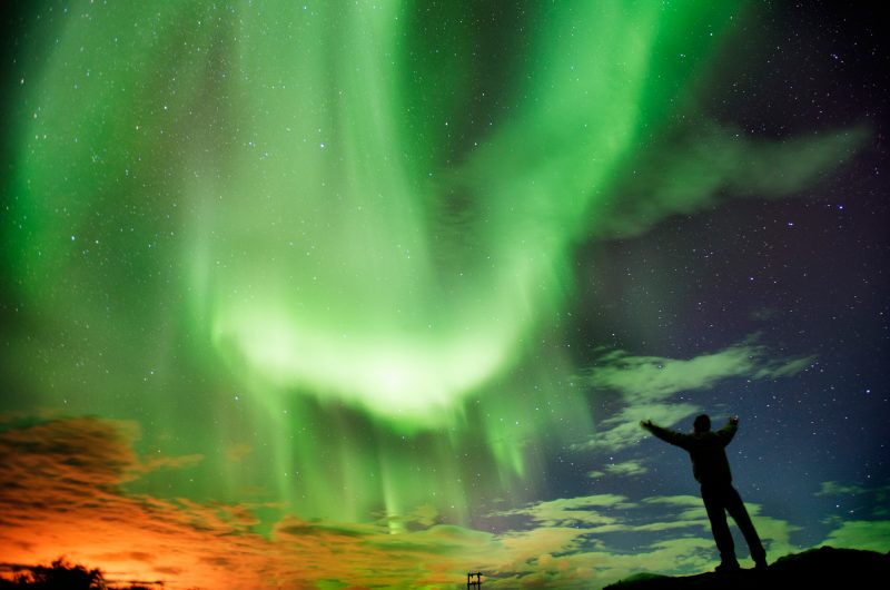 iceland aurora display with male istk