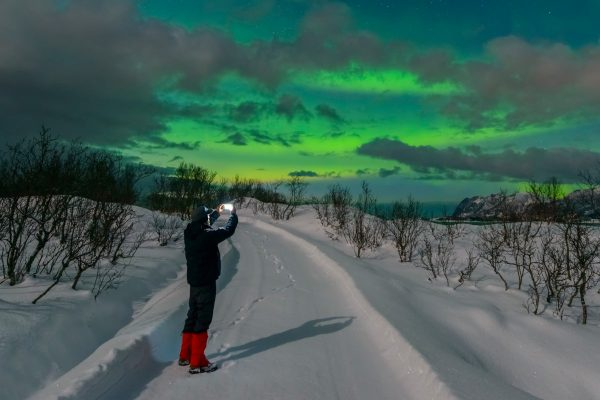 norway northern man with camera and aurora istk