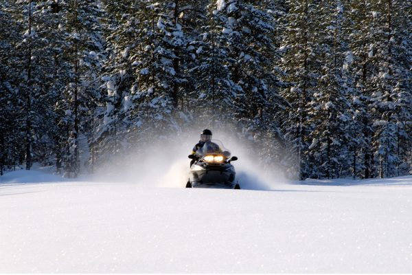 finnish lapland iso syote snowmobile with trees