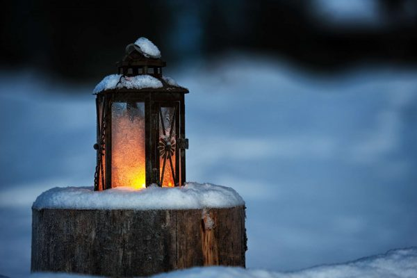 finnish lapland lantern on a log istk