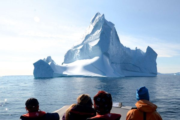 east greenland group on boat with iceberg ahead ch