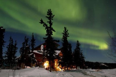 blachford lake lodge exterior against northern lights
