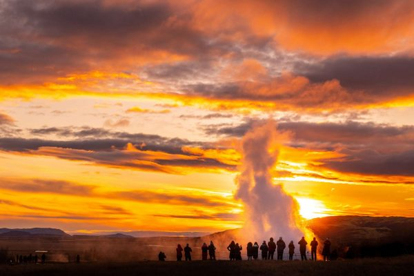 iceland south west strokkur geysir sunset people istk