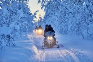 swedish lapland ripan snowmobiles in forest cr ys