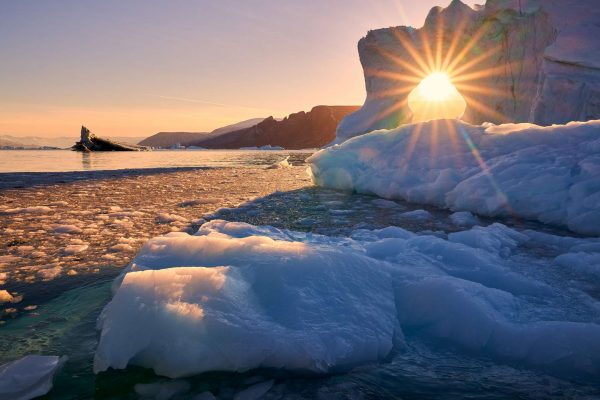 east greenland scoresbysund sunlight through ice rth