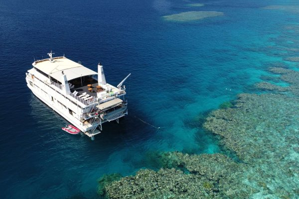 coral expeditions II ship and reef aerial view