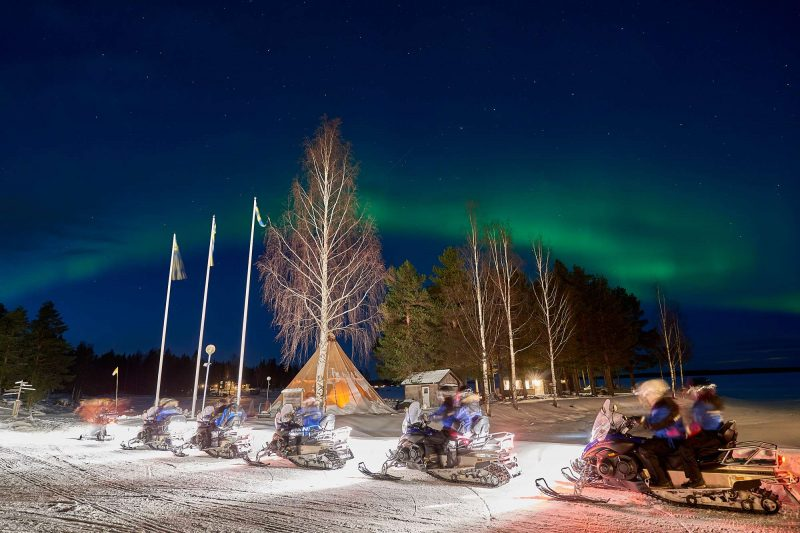 swedish lapland brandon lodge snowmobile train with aurora gr