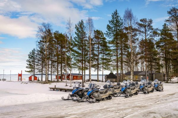 swedish lapland brandon lodge snowmobiles parked rth
