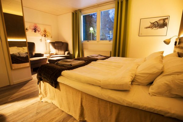 swedish lapland pine bay lodge bedroom wg