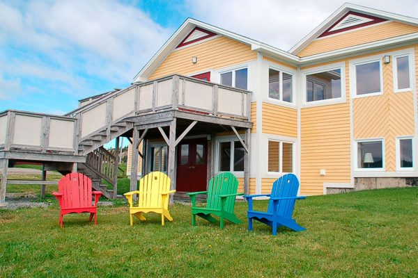 newfoundland neddies harbour inn with adirondack chairs
