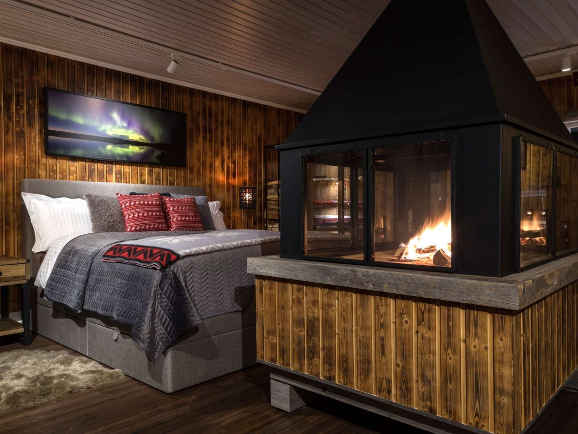 swedish lapland loggers lodge interior bed and fire ll