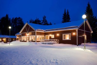 swedish lapland pine bay lodge exterior snow view pp