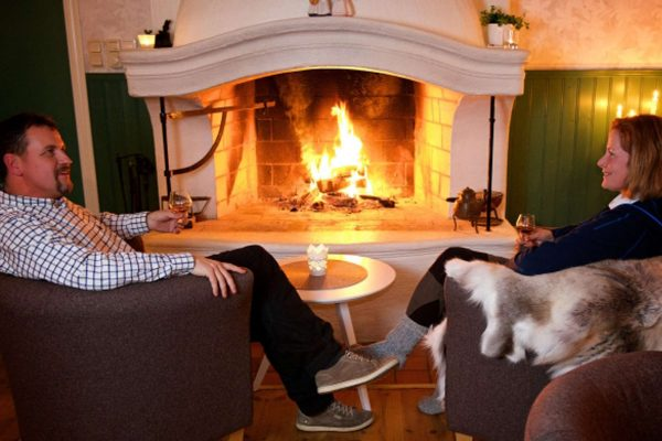 swedish lapland pine bay lodge fireside couple gr
