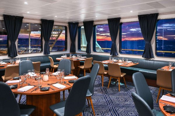 coral adventurer ship dining room sunset view