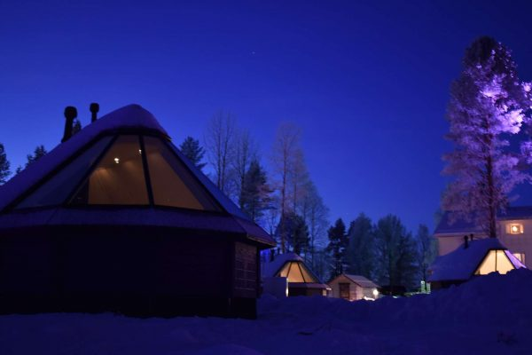 finnish lapland apukka resort aurora cabin exterior night