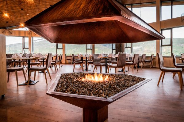 west hotel husafell dining area restaurant fire feature