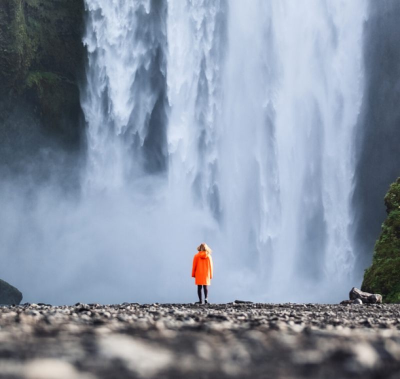 Woman in front of waterfall