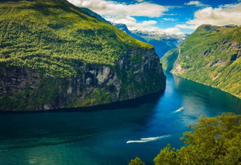 Fjord under cloudy sky