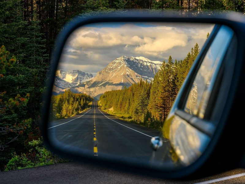 Wing mirror view of the Icefields Parkway