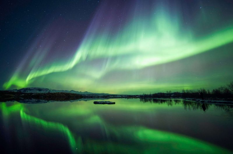 iceland northern lights reflected in lake thingvellir istk