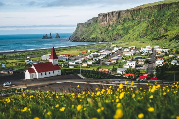 south iceland vik church and reynisdrangar sea stacks sunny day istk