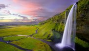 south west iceland seljalandsfoss pink sky robert lukeman unsplash