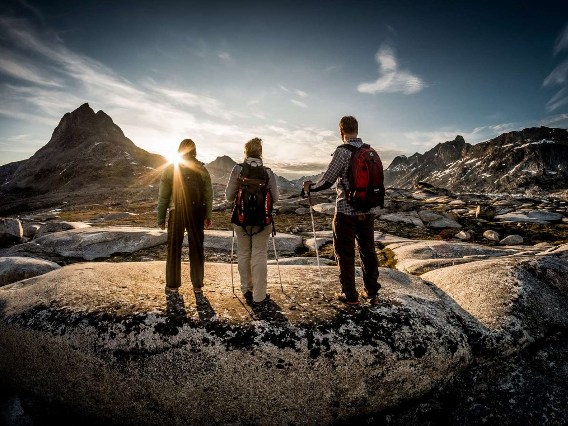 east greenland hikers admiring view vg
