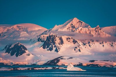 antarctica pink reflection on mountains istk